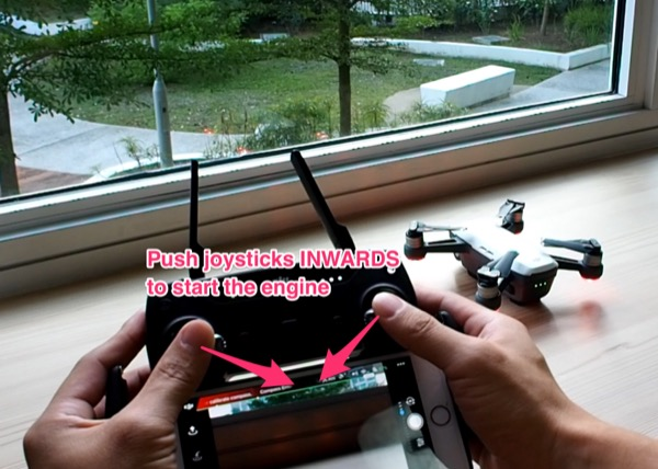 Push joysticks inwards